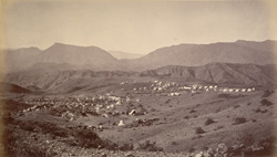 The camp on Shergai Heights - looking south - showing the old fort and hills towards Bazar.